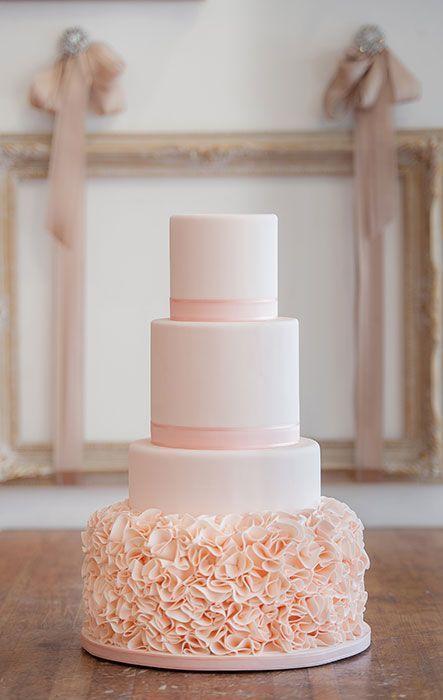 Soft blush ruffled wedding cake