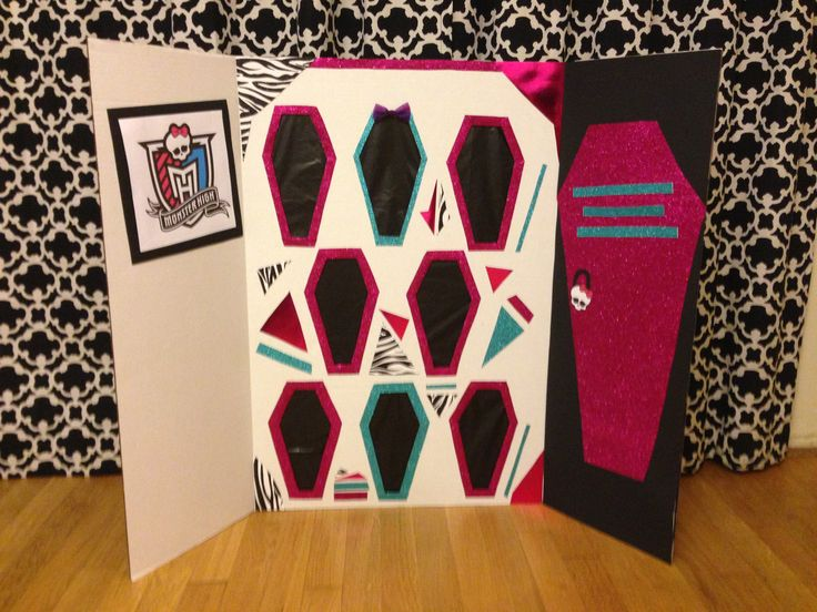 Monster High Birthday Party Game Idea - A revised version of the punch box game to match the Monster High Theme. Prizes are hidden behind the coffins that are actually tissue paper. #monsterhigh #birthday #partygames #games