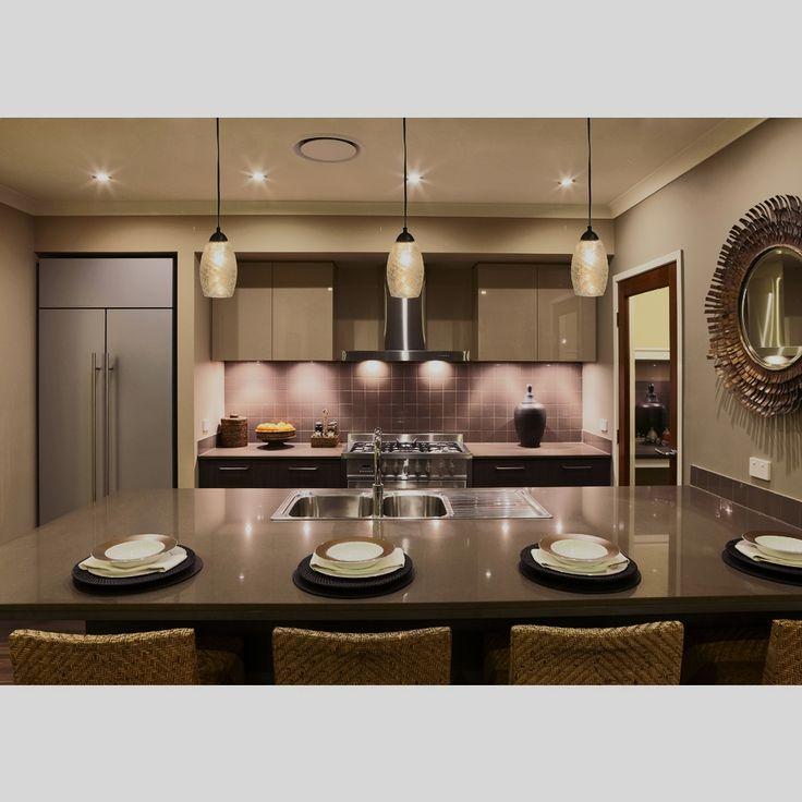 Mercury Glass Pendant Lights Cast A Warm Glow On This Sleek Kitchen