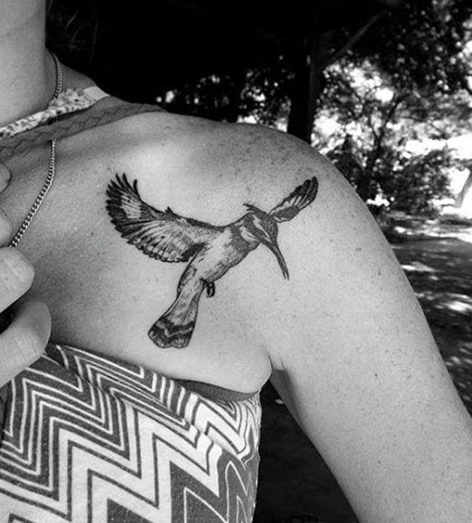 Tatuaggi a tema viaggio: uccello con ali spiegate