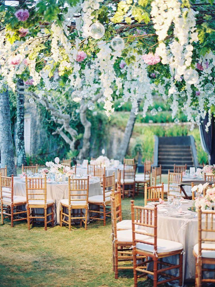 Gorgeous hanging floral decor: http://www.stylemepretty.com/2015/12/02/lush-bali-wedding-at-the-khayangan-estate/ | Photography: Angga Permana - http://anggapermanaphoto.com/