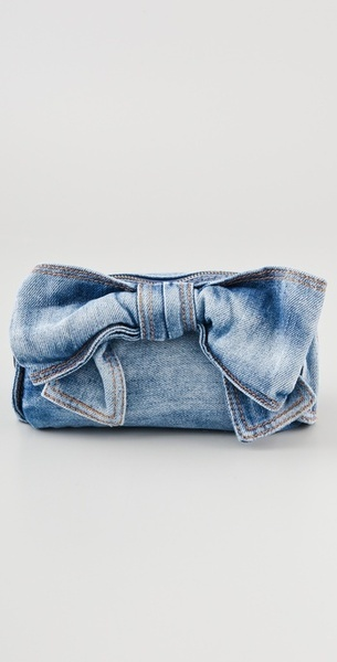 clutch    RED VALENTINO  Blue Denim Bow Cosmetic Pouch  This denim pouch features a bow detail at the front and a logo tag at the back. Contrast stitching. Zip closure.