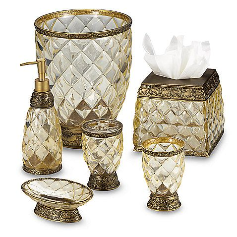 An attractive quilted design in clear resin is further enhanced by ornate gold-colored accents. Transform your bathroom with this attractive set.