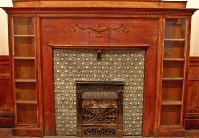 c. 1880's Victorian era solid oak wood mantel with unique bookcase ends.