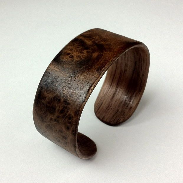 Bent wood bangle from walnut veneer. burl wood on the outside layer for awesomeness.