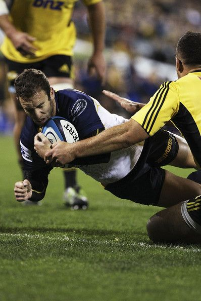 Nic White of the Brumbies scores a try during the round 16 Super Rugby match between the Brumbies and the Hurricanes at Canberra Stadium on May 31, 2013 in Canberra, Australia.