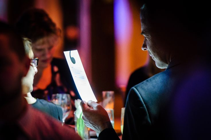 A guest views the menu at the BNZ Literary Awards 2014. The Great Hall, Buckle Street, Wellington. Wednesday 17 September 2014.
