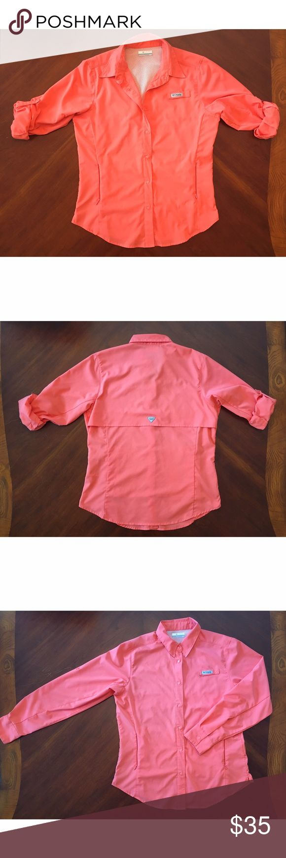 "Pink Columbia PFG Long Sleeve Shirt Columbia Sportswear Women's Tamiami™ Long Sleeve Shirt. Size M. Never worn. Color is named ""Red medium"" but it's really a salmon pink color. Super cute, very sporty! A great preppy look. UPF 40 for protection against UVA/UVB rays. Lightweight fabric. Zippered pockets. Mesh-lined for great airflow. Bought from a sporting goods store but never worn. Make an offer!! *will sell for less on Merc* Columbia Tops Button Down Shirts"