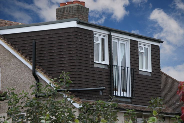 rear dormer loft conversion with black tiles south london