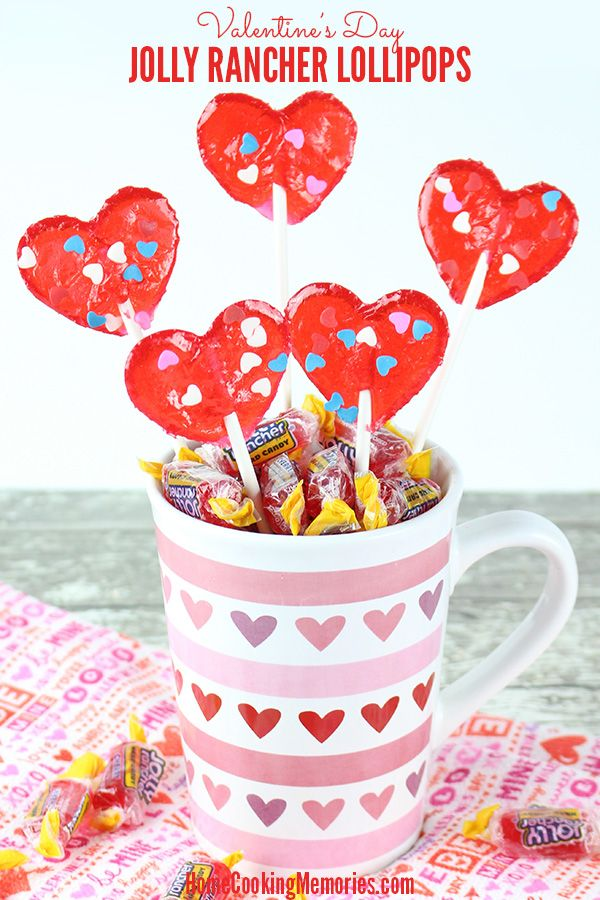 DIY Valentine Jolly Rancher Lollipops - with an oven-safe candy mold, you can make and decorate your own lollipops from Jolly Rancher hard candies! Use long lollipop sticks to create a lollipop bouquet or shorter sticks to give out single lollipops to friends and family. Fun idea for Valentine's Day.