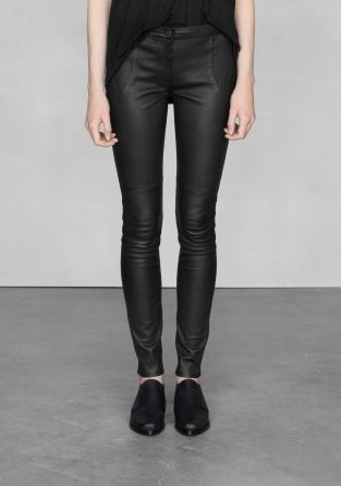 & OTHER STORIES Made from smooth, creamy leather, these trousers have a clean, slim fit design. - Narrow waistband- Defined seams in the front and back- Trousers close in the front with a hidden zip and antique silver coloured button- Inside leg: 76.3 cm (size 38)