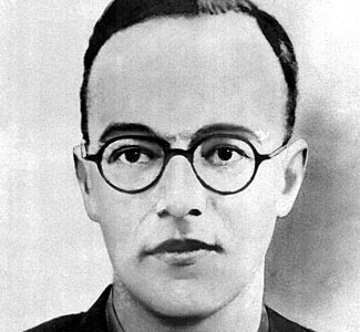 Klaus Fuchs was born in the Grand Duchy of Hesse, third child to Lutheran Pastor Emil Fuchs. His father was later a professor of theology at Leipzig University. He became an active Quaker in Germany, England, and in the USA. His grandmother, mother, and his older sister committed suicide to avoid capture by the Nazis. He was a German-British theoretical physicist and atomic spy. Convicted in 1950 of supplying information from the American, British and Canadian  Manhattan Project to the USSR.