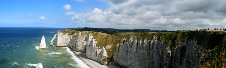 """Étretat, Pays de Caux, Seine-Maritime, Haute-Normandie, about 20 m NE of Le Havre at the junction of the D 940, D 11 and D 139, known for its cliffs including three natural arches and the pointed """"needle"""". The GR 21 long-distance hiking path (Le Havre to Le Tréport) passes through the town. Two of the three famous arches are seen from the town, the Porte d'Aval, and the Porte d'Amont. The Manneporte is the third and the biggest one, and cannot be seen from the town."""