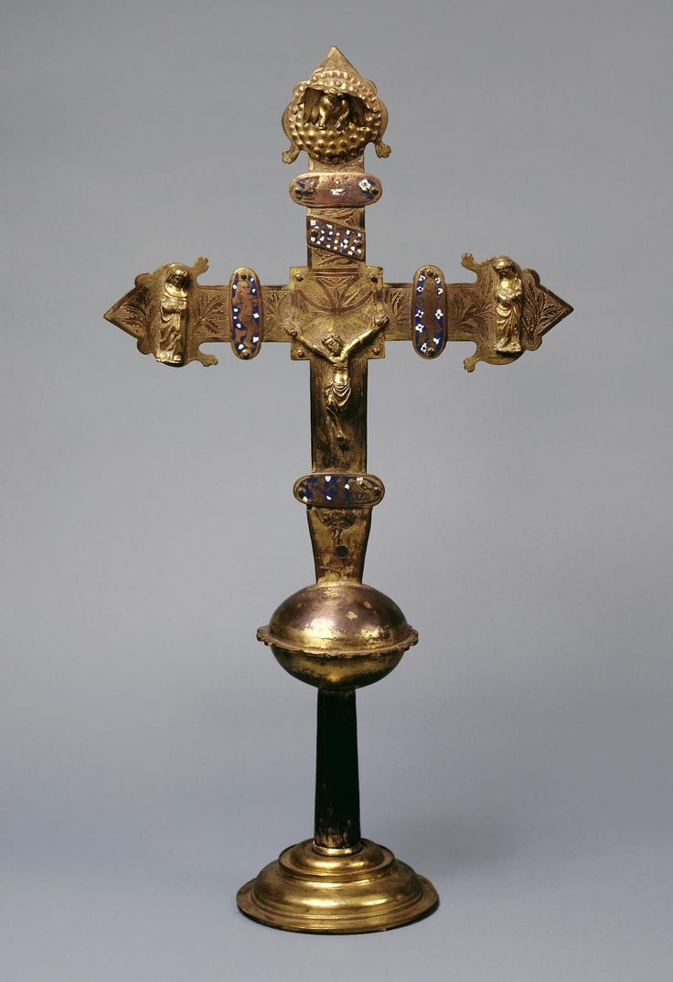 Processional Cross  Spain, Early 15th century  Name: Processional Cross Place of creation: Spain Date: Early 15th century Epoch. Period: Gothic Period School: Burgos Material: copper, wood and enamel Technique: chased, engraved and gilded Dimension: h. 69,5 cm