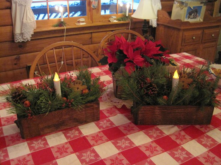 Christmas arrangements made from old sewing machine drawers - thinking about giving each sister a piece of my grandmother's sewing machine next year!