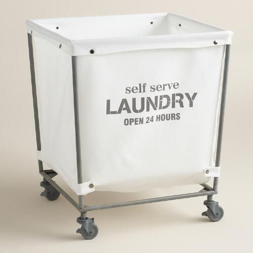 """A chic take on the classic laundromat cart, our rolling hamper features a removable cotton bag that reads """"self serve laundry open 24 hours"""" and snaps neatly onto its metal frame. Swiveling casters make it easy to lock into place or roll to and from the washer."""
