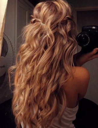 Wrap your hair around a large curling wand and spray a texturizing spray to give hair a fresh off the beach look. Finish by twisting two front pieces and securing in the back.