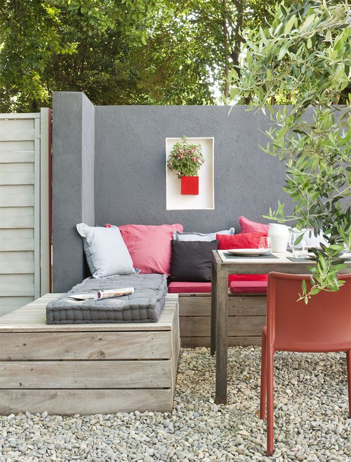 Outdoor seating, looks like it could be made from pallets or reclaimed wood, then use pretty coloured and patterned cushions to make it cosy
