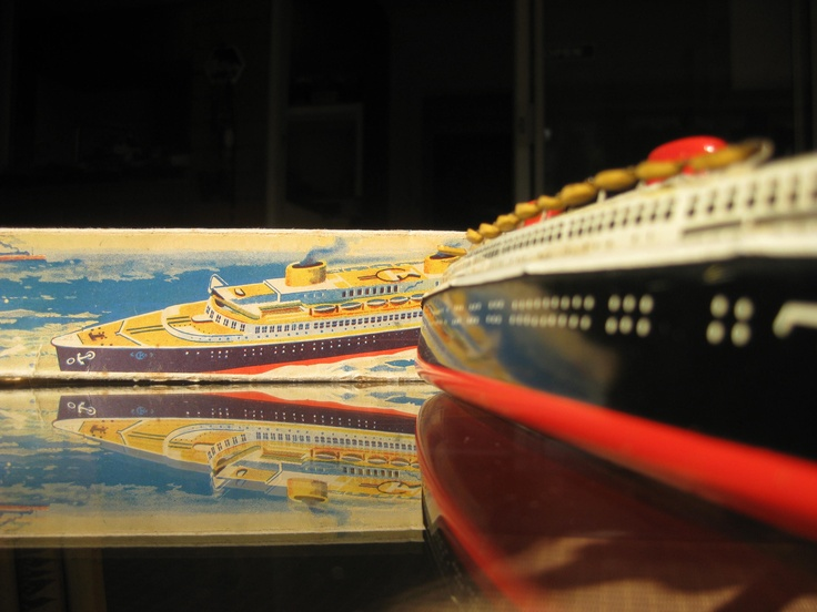 The glamour of ocean travel reflected in my 1950's wind up tin toy. Made in the then U.S. zone of Germany.