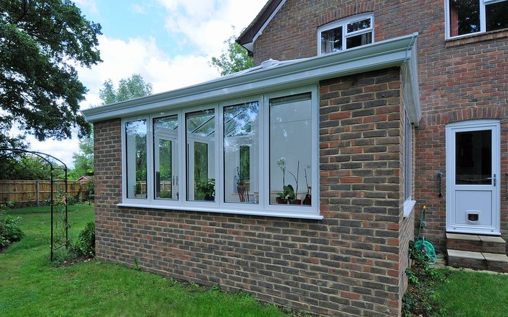 The external cornice on this garden room hides the guttering from view.