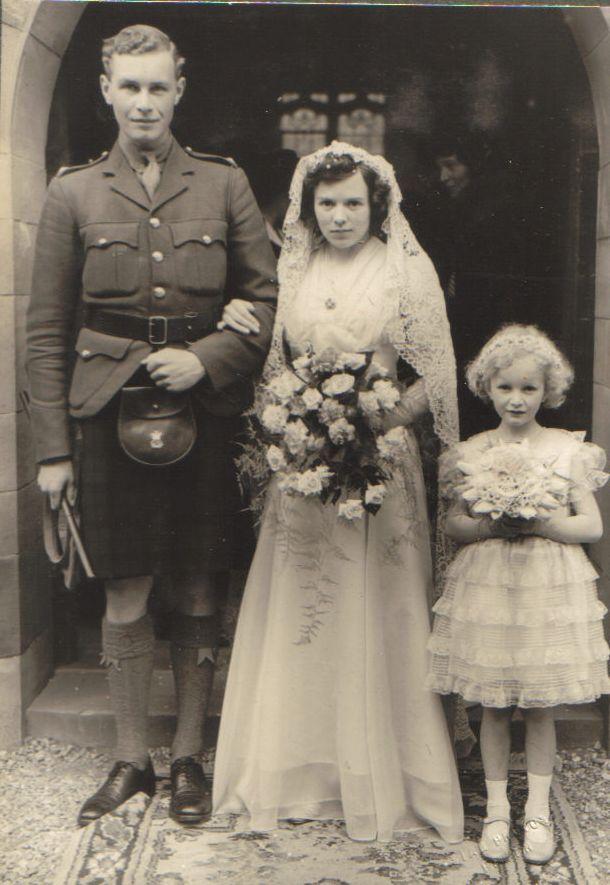 Ian Molteno and Margaret Pigot at their wedding (Fiona Molteno as bridesmaid), Glen Lyon, 15 May 1940