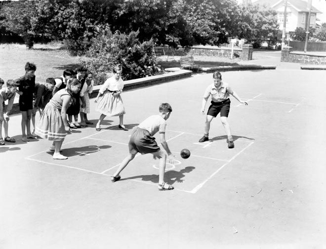 A group of children play four square in 1959. Four square is a game that simply requires a marked surface, a ball and four players. It began as a formal game at some time in the 1950s, and was soon adopted by children as a spontaneous game that could be played without adult supervision.