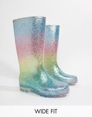 cdc1c2a906f8 Shop ASOS DESIGN Gransta Wide Fit rainbow glitter wellies at ASOS. Discover  fashion online.