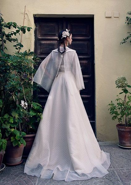 From Elisabetta Delogu Utopia collection, Plumetis cotton wedding gown, with macramé lace collar and cape. Photo Elisabetta Delogu