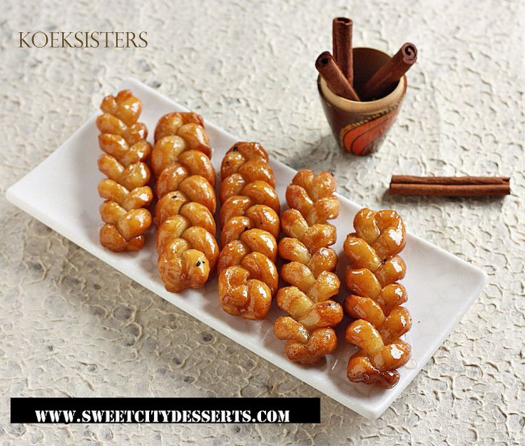 Have a taste of their KOEKSISTERS which is the African counterpart of doughnut. See its recipe in http://www.sweetcitydesserts.com/african-desserts/