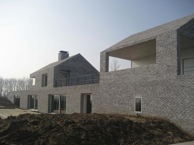 Stéphane Beel Architects villa h. te w . wortegem, love the integration of wall and building at upper level especially those voids