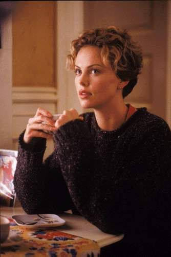 Charlize. I get told that I look a lot like her almost all the time; the top two movies of hers that I most closely resemble her: Sweet November and The Astronauts Wife.