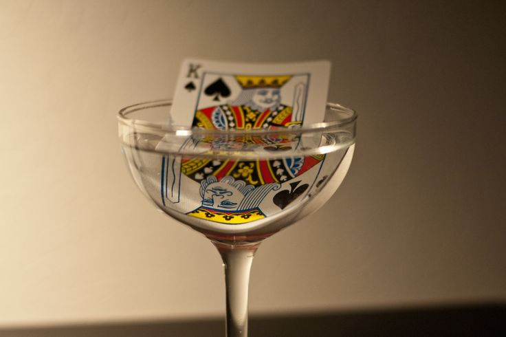 Plastic bridge cards in one glass of water