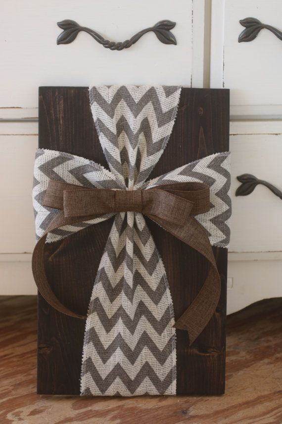 Dark stained wood with chevron cross and brown bow Dimensions are 18x11x2 Back has a wire hanger