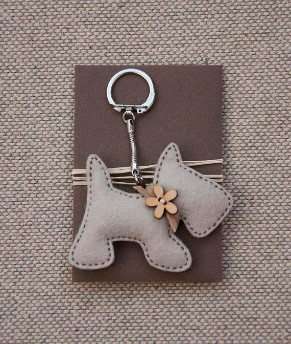 Little puppy with a wooden flower button - key chain pendant