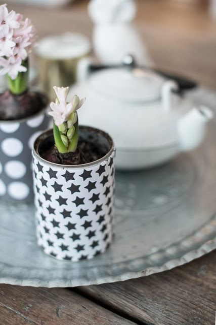 wrap tin cans with wrapping paper - add dirt and a bulb and wait for the flowers!