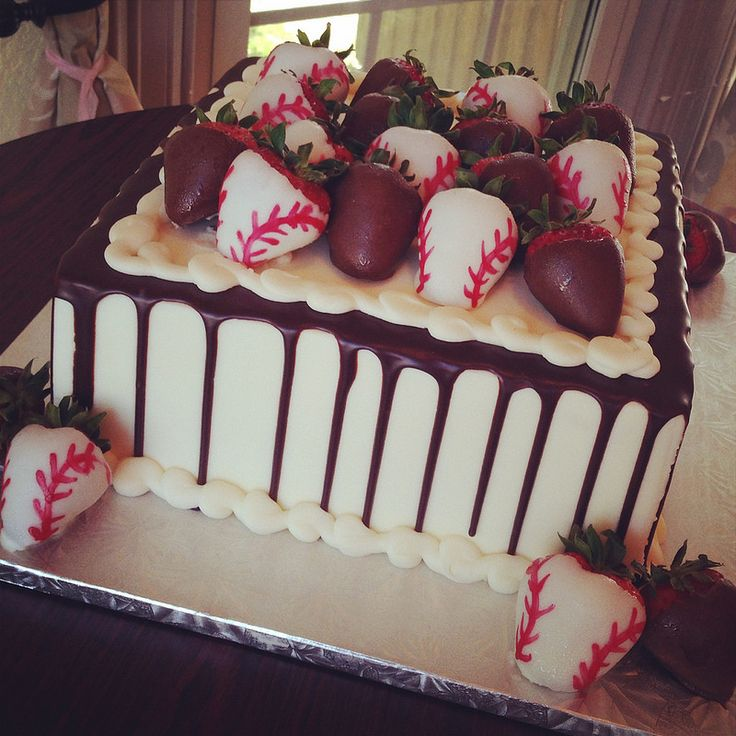 Vanilla buttercream iced grooms cake with chocolate drizzle and chocolate dipped baseball strawberries.  by sugarandfrosting.com