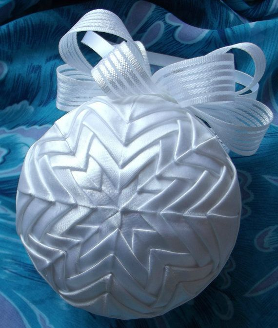 Quilted ornament. White satin over 9cm ball. Topped with white satin ribbon, this one just glows.  There may be a few more all one colour very