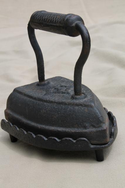 Old antique Geneva star clothes iron & cast iron trivet stand