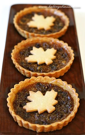 "Canadian butter tarts with maple syrup: Maple syrup is added to the raisin filling and we soaked the raisins in Canadian Whisky. The crust is a buttery tart crust. And since I love my crust ""well-done"", nicely browned and flavorful, I prebaked the crusts before filling them."