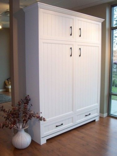 Murphy bed, white: I love the bead board on this. We bought a bed-kit, and my hubby has finished building it and just installed it. It looks great!