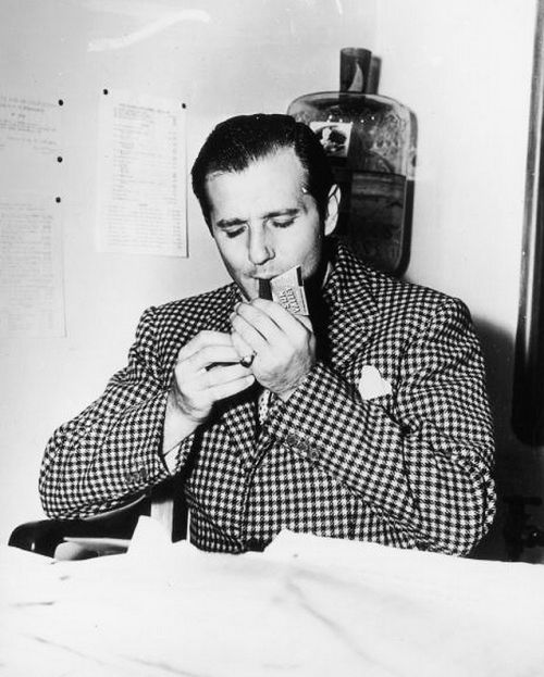 "Mobster Benjamin ""Bugsy"" Siegel lights his cigar, 1940."