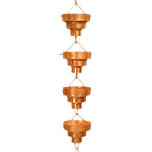 """Watch as rain spills down our beautiful copper Bamboo Rain Chain. In Japan, rain chains or """"kusari doi"""" have been around for hundreds of years to provide a beautiful and functional watercourse for rain. Japanese rain chains are a decorative alternative to the downspout or rain gutter pipe. Simply insert into your existing rain gutter drain hole or place it on a corner eave of your home or patio. Watch the beauty of water cascading down and over each copper hammered bowl."""