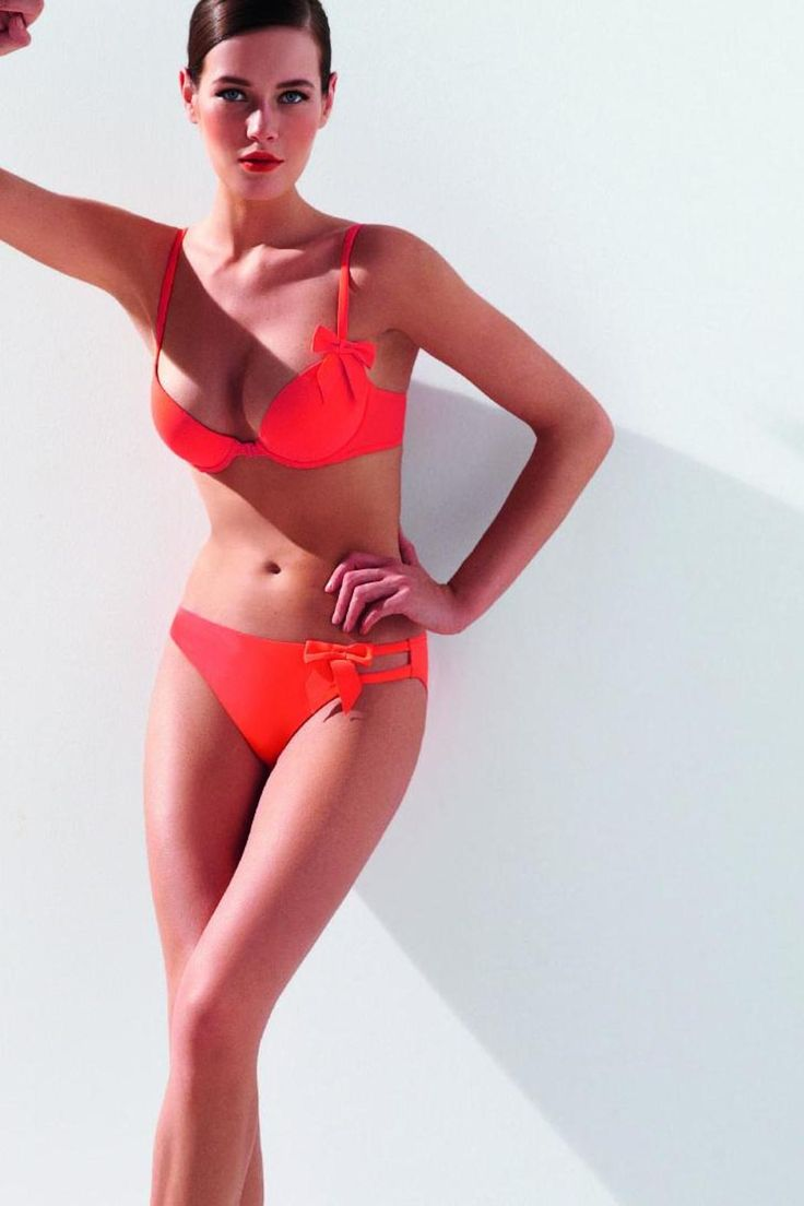 Orange plunge bikini top with front fastener and detailed back with bow. Light foam cups with adjustable straps.   Orange Bikini Set by Simone Perele. Clothing - Swimwear - Two-Piece Canada