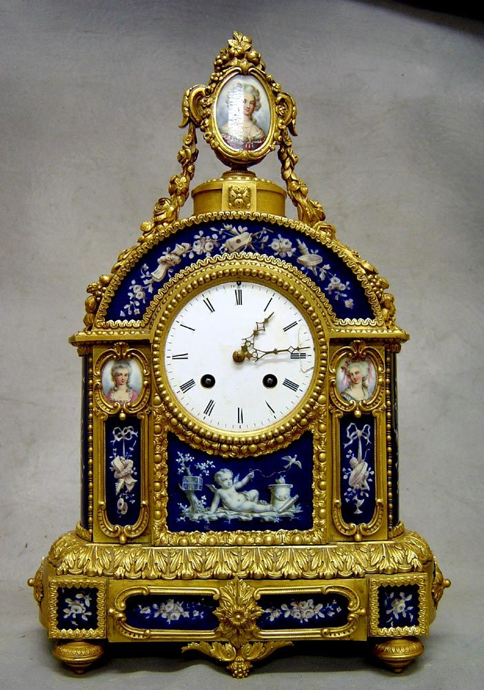 A good French late 19th century ormoluGavin Douglas Antiques and porcelain mantel clock. In the Louis XVI style the clock is decorated to the front and sides with porcelain panels of grissaille decoration of flowers and Cupid on a cobalt blue ground. The ormolu is original and in mint conditiion. 8 day bell striking movement. White enamel dial with gilt hands. Circa 1880