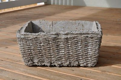 handmade flower pots using baskets with a box inside to form the inner mold, for complete instructions follow the Martha Stewart link in article