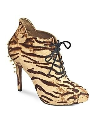A studded gold-tone plate offers an unexpected finish on Sam Edelman's wild, animal-printed calf hair booties.