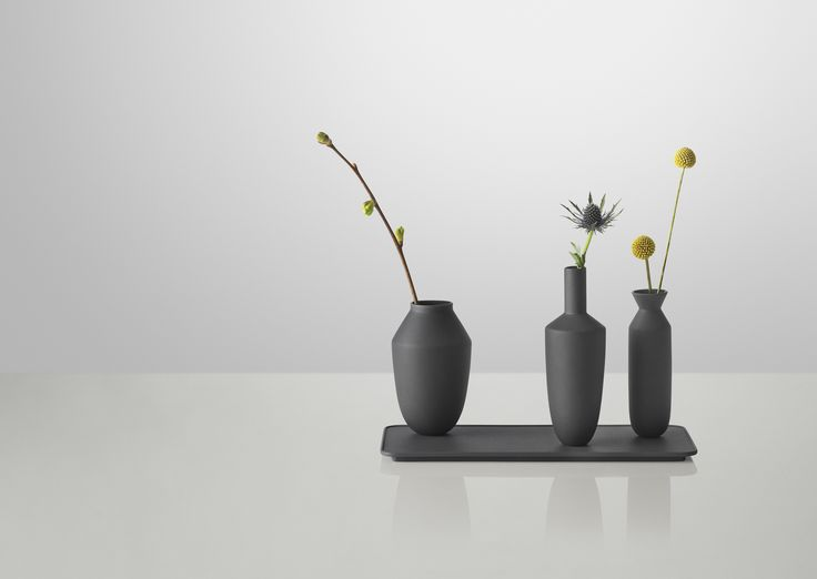 MUUTO ADDS BALANCING VASES TO ITS LINE OF ACCESSORIES.   THE BALANCE VASE SETS are designed by Hallgeir Homstvedt for Muuto. Balance is a set that mix different shapes and contemporary colors of vases and trays. The vases are casted in colored clay and the tray in steel. Keeping the vases and trays together is a strong hidden magnet, which locks them in an upright balanced position while at the same time allowing the vases to be moved around on the tray, for a personalized look.