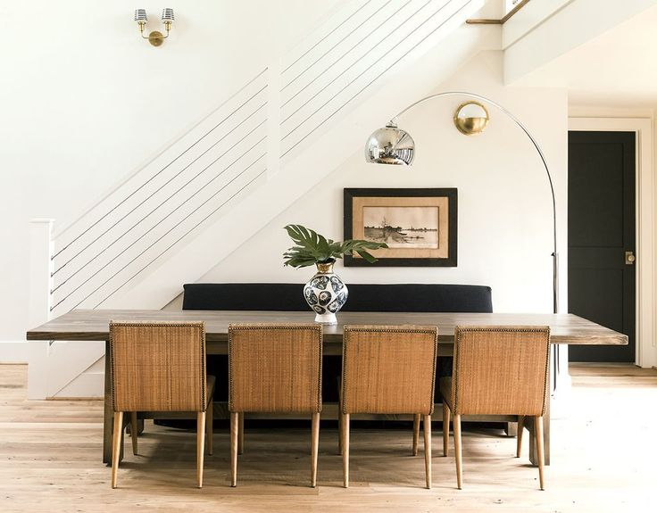 Steel Cable Stair Railing And An Arc Lamp Keep The Dining Room Modern Photograph