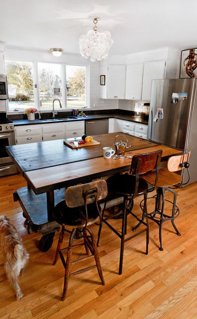The kitchen looks boring, but the stools I lust for