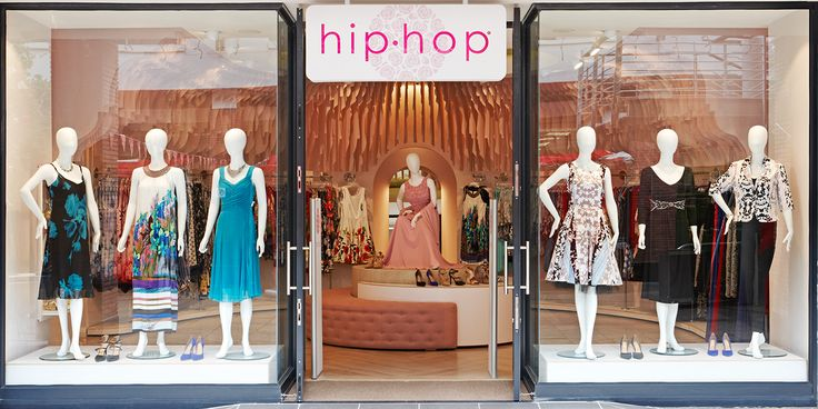 Hip Hop Clothing Store | interior design by Haldane Martin | photos by Micky Hoyle  The store fascia features the pink logo in Helvetica typeface, combining a feminine aesthetic with contemporary sensibility.  A raised plinth showcases 9 mannequins, instrumental in creating best-sellers for fashion stores, as has been shown through past retail experience by Haldane Martin.  This unique interior for Hip Hop is emblematic of the award-winning design studio's innovation in commercial design.